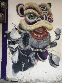"""Lion Dance Breaking Out of Wall"""